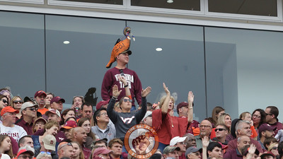 A Virginia Tech fan with a unique hat stands up in the West stands during the game. (Mark Umansky/TheKeyPlay.com)