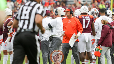 VT defensive coordinator Bud Foster meets with his players during a media timeout. (Mark Umansky/TheKeyPlay.com)