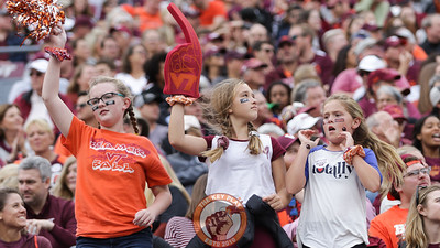 Fans dance to music from Hokievision during a media timeout. (Mark Umansky/TheKeyPlay.com)