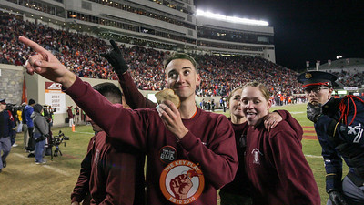 A cadet holds up a sandwich for Hokievision late in the game. (Mark Umansky/TheKeyPlay.com)