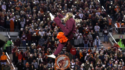 A Virginia Tech cheerleader is thrown into the air during a media timeout. (Mark Umansky/TheKeyPlay.com)