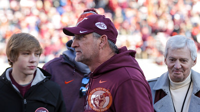 Hokies defensive coordinator Bud Foster reacts as he is honored in a pre-game ceremony. (Mark Umansky/TheKeyPlay.com)