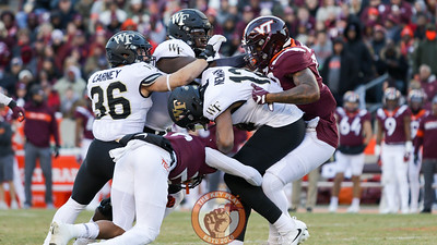 Wake Forest QB Jamie Newman is sacked for a loss by Jovonn Quillen and Jaevon Becton. (Mark Umansky/TheKeyPlay.com)