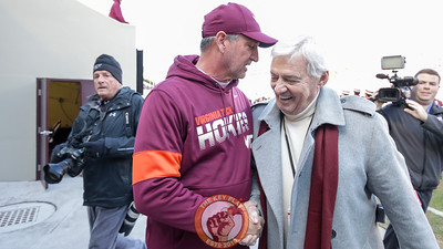 Hokies defensive coordinator Bud Foster greets former Hokies head coach Frank Beamer on the sidelines during pre-game warmups. (Mark Umansky/TheKeyPlay.com)