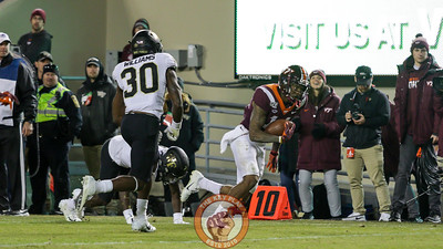 WR Damon Hazelton avoids a Wake Forest tackle near the sideline after a catch. (Mark Umansky/TheKeyPlay.com)