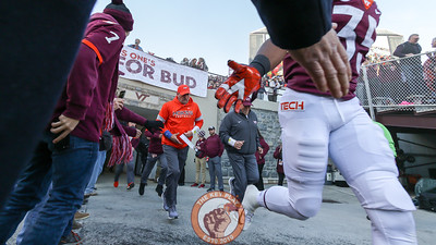 Hokies DC Bud Foster runs into Lane Stadium during Enter Sandman before kickoff. (Mark Umansky/TheKeyPlay.com)