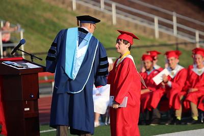 Class salutatorian Derek Lewis receives recognition.