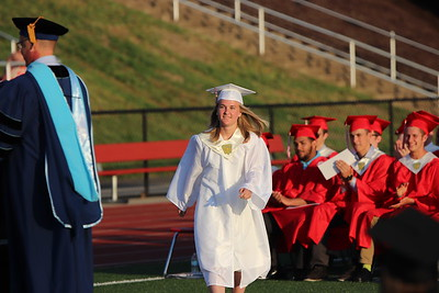 Class valedictorian Kayleigh Early walks to receive her honor.