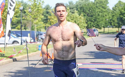 1rst place, Kevin Serrao, from Cambridge. The firecracker 5K in Wall, NJ on 7/4/19. [DANIELLA HEMINGHAUS | THE COAST STAR]