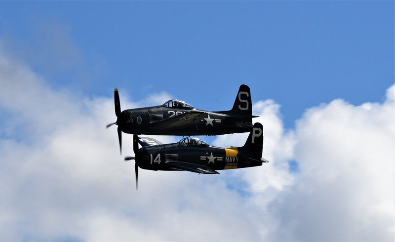 Love this formation and cloud drama in this photo of a couple of Bearcats.