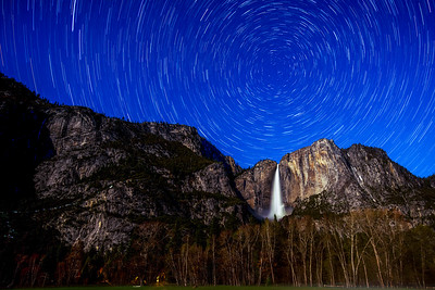 Polaris centered over Upper Yosemite Falls. The string of lights to the left is from the headlamps of a group hiking up to the falls in the predawn hours.