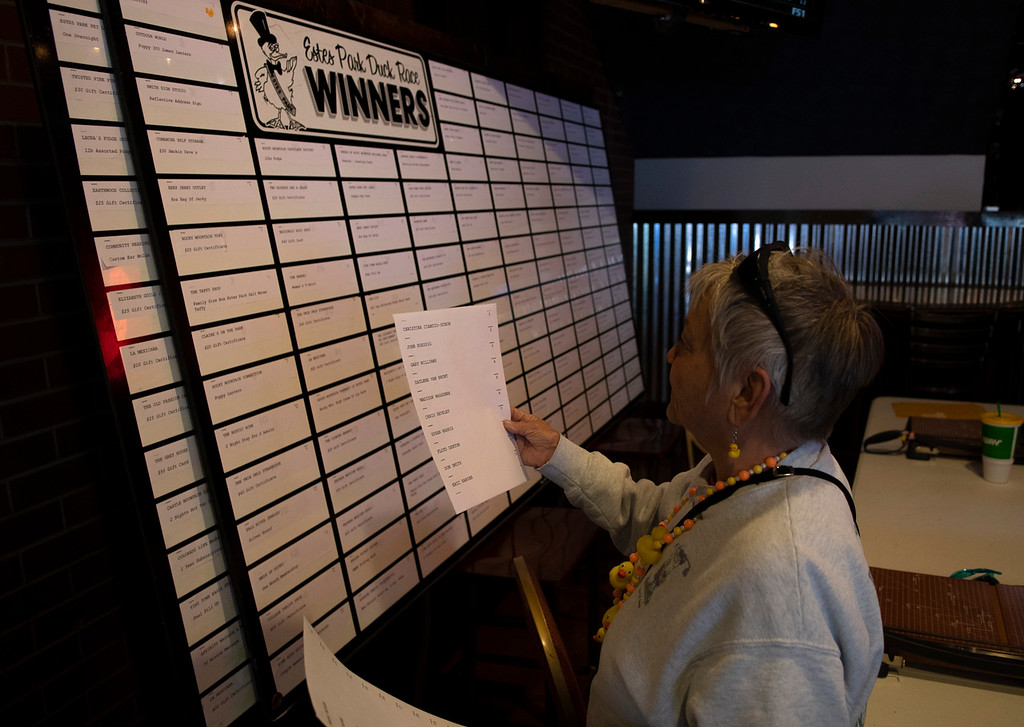 . Barb Widrig reads the results for the winners of the Estes Park Duck Race inside the Wheel Bar on May 3, 2019.