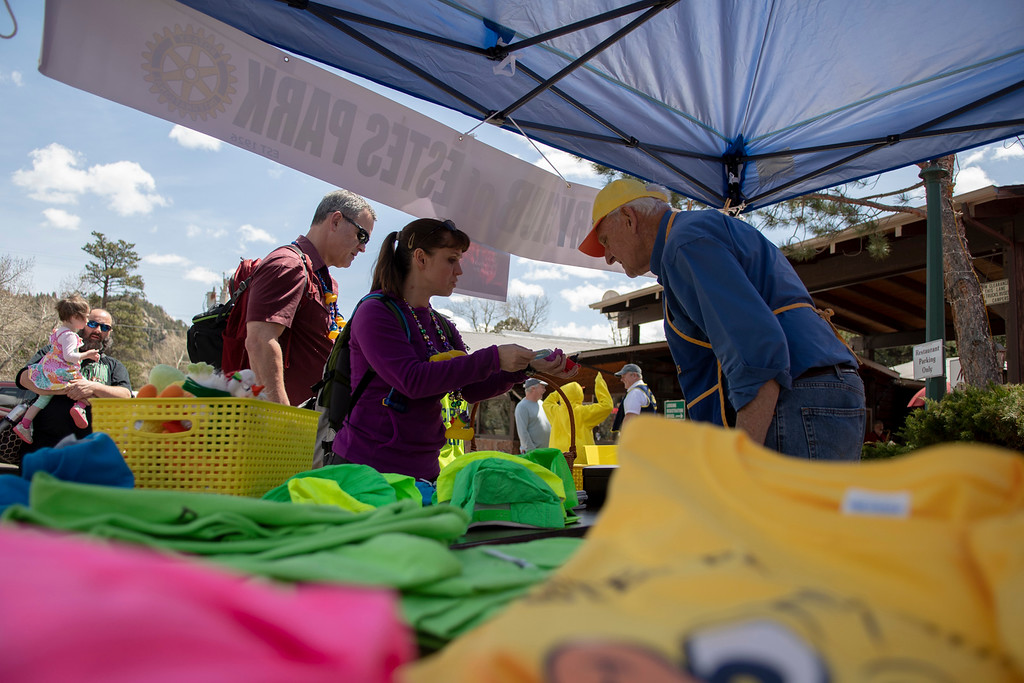 . Attendees of the Estes Park Duck Race recieve information about the event before the ducks dropped at 1 p.m.