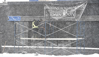 Workers brave the snow storm Tuesday morning to do some work on the new Brown's socail House location in the Pine Centre mall. citizen photo by Brent Braaten