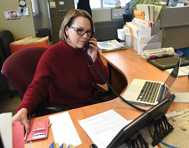 Prince George Citizen publisher Colleen Sparrow answers phiones Thursday morning. The Citizen press had a mechanical breakdown Wednesday evening causing a delay in getting Thursdays paper out. Citizen photo by Brent Braaten
