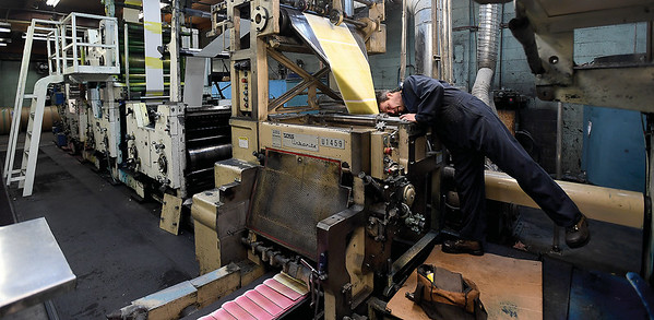 Prince George Citizen press forman Al Wilson works on repairing the folder on the press Thursday morning. A part broke Wednesday evening causing a delay in getting out Thursday paper. Citizen photo by Brent Braaten