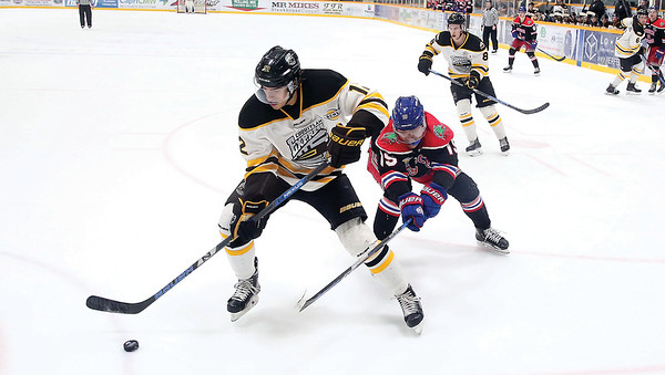 Prince George Spruce Kings forward Chong Min Lee goes hard on the forecheck against Coquitlam Express forward Ty Westgard on Friday night at Rolling Mix Concrete Arena. Citizen Photo by James Doyle       January 25, 2019