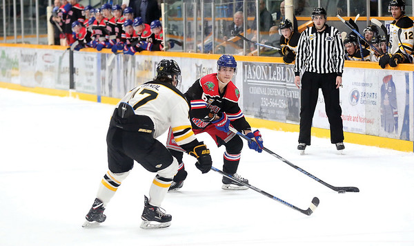 Prince George Spruce Kings defenceman Jay Keranen looks to make a play with the puck while being closely watched by Coquitlam Express defender Chase Danol on Friday night at Rolling Mix Concrete Arena. Citizen Photo by James Doyle       January 25, 2019