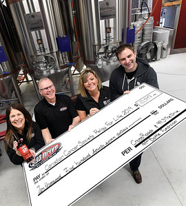 Crossroads Brewing Company and 99.3 The Drivemade a donation of $10,547 to the Canadian Cancer Society's Relay for Life initiative. The proceeds came from 99.3 The Drive's 15th anniversary 99th Bottle in partnership with Crossroads Brewing Company. Left to right 99.3 morning show hosts Carol Gass, Doug Jones, Aimee Cassie Canadian Cancer Society and Crossroars Brewing co-owner Bjorn Butow. Citizen photo by Brent Braaten
