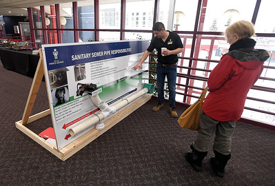 Jon LaFontaine with the City of Prince George explains how a typical house is conected to the sanitary sewer system during a open house at the Civic Centre Wednesday. Citizen photo by Brent Braaten