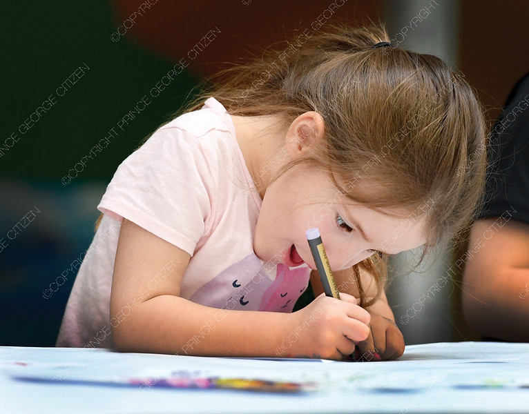 "Bridget Nagasaka, 5, works on a collaborative drawing Friday morning during the Two Rivers  Gallery Spring Break Art Camp. Children learned a variety of different art techniques during the week long ""Art of Imagineering"". citizen photo by Brent Braaten"