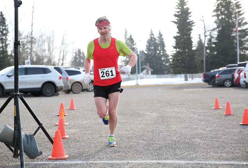John Hagen makes his way across the finish line on Sunday morning after completing the 5 km distance of the Heights 5'er. Hagen finished the run with a time of 19:56. 115 runners took part in the annual race hosted by the Prince George Road Runners with 66 runners tackling the 5km distance, and 49 runners taking on the 5 mile distance. Citizen Photo by James Doyle       March 24, 2019