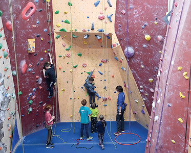 Children do some climbing in the Overhang Climbing Gym Monday morning during their spring break camp. Children in the camp also get to do outdoor exploration, snowshoing, sledding, curling and arts and crafts. Citizen photo by Brent Braaten