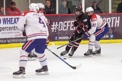 Cariboo Cougars forward Brett Fudger attempts to stickhandle the puck through three Vancouver North East Chiefs defenders on Saturday afternoon at Kin 1 during the second game of a best-of-three BCMML semifinal series. Citizen Photo by James Doyle       March 23, 2019