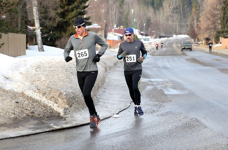 Shayne Hoehn (265), and Dennis Balogh (251) make their way along Malaspina Avenue on Sunday morning while competing the 5 km distance of the Heights 5'er. Hoehn fnished with a time of 21:32 and Balough was ten seconds back finishing with a time of 21:42. 115 runners took part in the annual race hosted by the Prince George Road Runners with 66 runners tackling the 5km distance, and 49 runners taking on the 5 mile distance. Citizen Photo by James Doyle       March 24, 2019