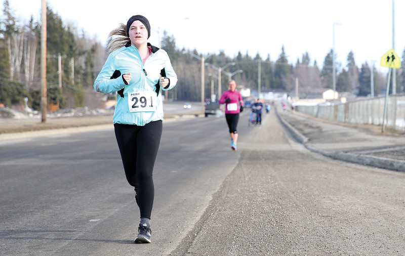 Jennifer Kubas makes her way along Domano Boulevard on Sunday morning while competing 5 mile distance of the Heights 5'er. Kubas finished with a time of 41:39. 115 runners took part in the annual race hosted by the Prince George Road Runners with 66 runners tackling the 5km distance, and 49 runners taking on the 5 mile distance. Citizen Photo by James Doyle       March 24, 2019
