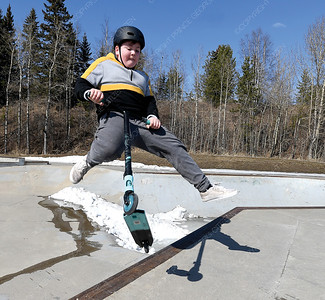 Ethan Bach, 12, does a tail whip up a quater pipe Wednesday aftetnoon at the Rotary Skatepark. Even with snow left in the park kids are able to find enough dry area to skate and ride. Citizen photo by Brent Braaten