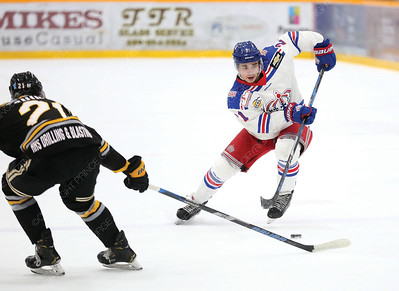 Prince George Spruce Kings forward Nick Bochen sneaks the puck past the outstretched stick of Victoria Grizzlies defender JOrdan Guiney on Friday night at Rolling MIx Concrete Arena. Citizen Photo by James Doyle       March 29, 2019