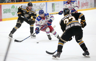 Prince George Spruce Kings forward Patrick Cozzi tries to stickhandle the puck around the check of a pair of Victoria Grizzlies defenders on Friday night at Rolling MIx Concrete Arena. Citizen Photo by James Doyle       March 29, 2019