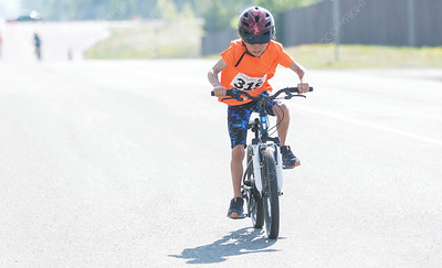 Sully Nelson pedals down 18th Avenue near Prince George Aquatic Centre on Sunday morning while competing in the 25th Annual Integris Kids of Steel Triathlon. Citizen Photo by James Doyle      May 26, 2019