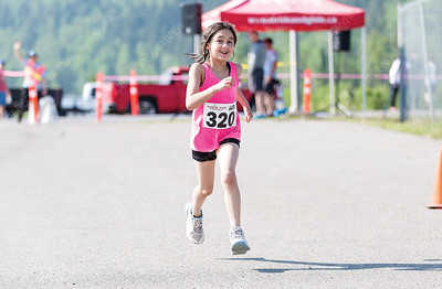 Eesha Dhanjal crosses the finish line on Sunday morning while competing in the 25th Annual Integris Kids of Steel Triathlon. Citizen Photo by James Doyle      May 26, 2019