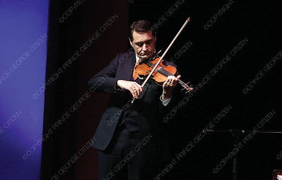 David Shenton plays the violin on Sunday night at Prince George Playhouse during O Sole Trio's Bravissimo Broadway performance. The trio performed a number of classic Broadway hits from such musicals as Cats, and Phantom of the Opera. Citizen Photo by James Doyle       May 26, 2019