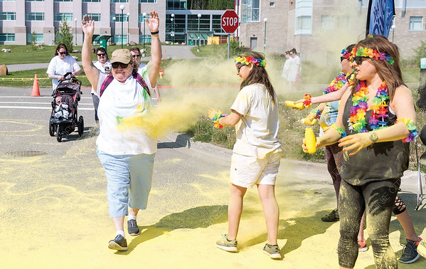 Yellow colour covers a walker on Sunday morning during the first annual Prince George Hospice Society Colour Walk at UNBC. Citizen Photo by James Doyle   May 26, 2019
