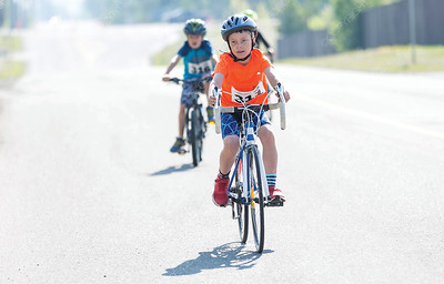 Levi Wilkinson pedals down 18th Avenue near Prince George Aquatic Centre on Sunday morning while competing in the 25th Annual Integris Kids of Steel Triathlon. Citizen Photo by James Doyle      May 26, 2019