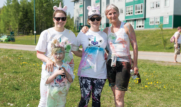 Bailey WIlson-Beaulieu, 5, left, Isabella Wilson-Beaulieu, Terra Decooman, and Margot Parent pose for a photo on Sunday morning during the first annual Prince George Hospice Society Colour Walk at UNBC. Citizen Photo by James Doyle   May 26, 2019