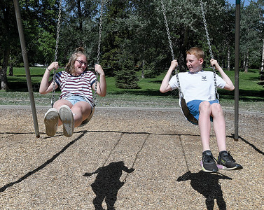 Léonie Dutil, 13, from Collège de Lévis in Lévis Quebec and Cohen Milne, 12, from Ecole Lac des Bois use the swings in Lheidli T'enneh Memorial Park Wednesday afternoon. The two schools are participating in a exchange funded by Experiences Canada. 44 students from Lac des Bois went to Quebec ion February and 34 students from Lévis are in Prince George this week seeing the sights of the region that included, Ness Lake, Barkerville and Mount Robson.