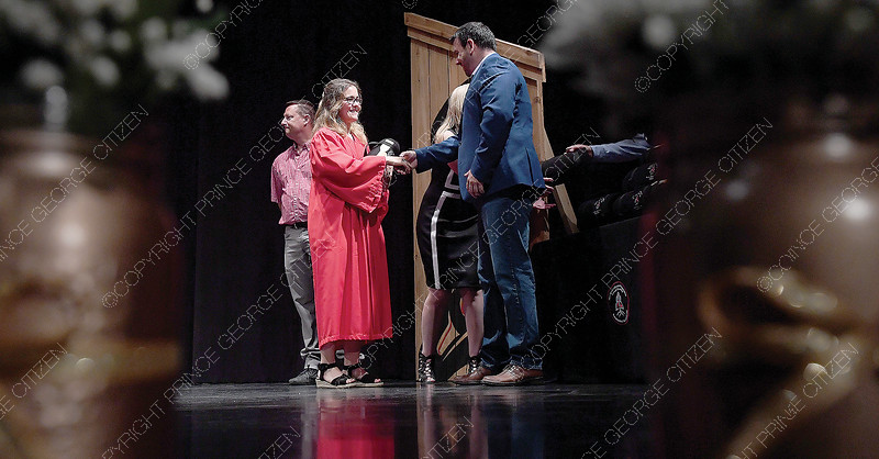 Julie Williams from Ulkatcho Nation and a graduate of Valemount Secondary is congratulated by Lheidli T'rnneh Chief Clay Pountney During the School District's inaugural Aboriginal Graduation Ceremony – or Ts'udelhti, which means We Honour in Dakelh Lheidli dialect on Thursday at Vanier Hall. Citizen photo by Brent Braaten