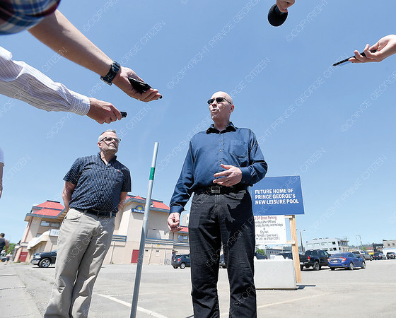 Architect Mark Hentze, centre, and Dominic Ries, project manager address the media at the site of the new swimming pool in downtown Prince George Thursday afternoon. citizen photo by Brent Braaten