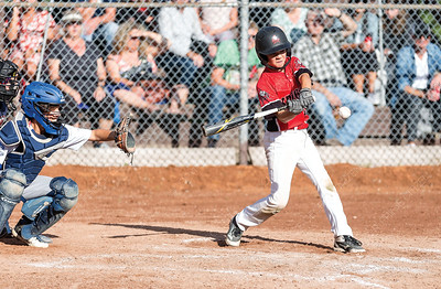 PG Floor Fashions Knights player Peyton Mackay swings a pitch against the Quesnel Blue Jays on Saturday evening at Gyro Park. The Knights took on the Blue Jays in Single-A peewee baseball zone playoffs. Citizen Photo by James Doyle        July 27, 2019