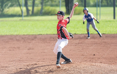 PG Floor Fashions Knights player Karson Hursarski hurls a pitch against the Quesnel Blue Jays on Saturday evening at Gyro Park. The Knights took on the Blue Jays in Single-A peewee baseball zone playoffs. Citizen Photo by James Doyle        July 27, 2019
