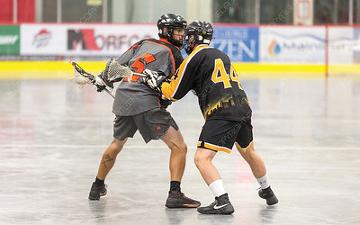 "Westwood Pub Devils player Danton Nicholson looks to make a play against PoCo Hitmen defender Fraser Miller on Saturday night at Kin 1 as the two teams met in the Senior ""C"" Provincial lacrosse championship and Treasure Cove Casino Senior Invitational lacrosse tournament. Citizen Photo by James Doyle      July 27, 2019"