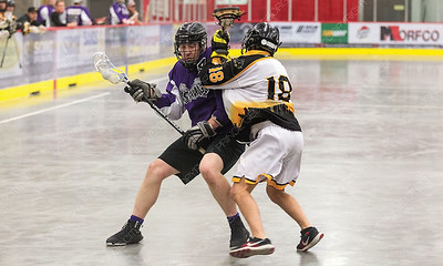 """Northland Nissan Assault player Cole Kulczyski looks to make a play while being checked by Poco Hitmen defender Nolan Riches on Saturday afternoon at Kin 1 as the two teams met in the Senior """"C"""" Provincial lacrosse championship and Treasure Cove Casino Senior Invitational lacrosse tournament. Citizen Photo by James Doyle      July 27, 2019"""