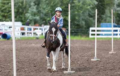 Seven-year-old Francis MacMillan and her horse Pongo compete in the pole bending event at the Pineview Riding Arena on Sunday morning during the Timberline Gymkhana that was hosted by the Timberline Riders Gymkhana Club. Citizen Photo by James Doyle       July 28, 2019