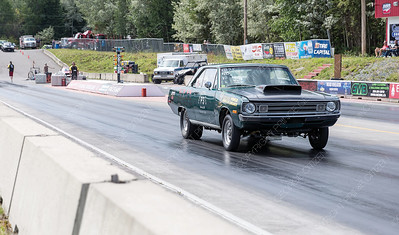 The no-box drag racer of Brian Vader speeds down the Rolling MIx Concrete Raceway on Sunday afternoon at NITRO Motorsports Park during the Big Bux Shootout drag races. Citizen Photo by James Doyle        July 28, 2019