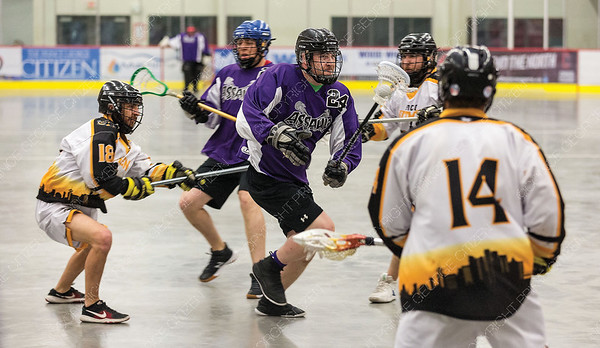 "Northland Nissan Assault player Cole Kulczyski looks to make a play while being checked by PoCo Hitmen defenders on Saturday afternoon at Kin 1 as the two teams met in the Senior ""C"" Provincial lacrosse championship and Treasure Cove Casino Senior Invitational lacrosse tournament. Citizen Photo by James Doyle      July 27, 2019"