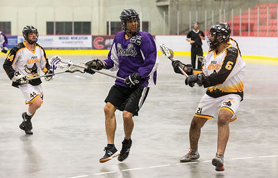 "Northland Nissan Assault player Brian McAdie looks to make a play while being checked by PoCo Hitmen defender Rajun Hyare on Saturday afternoon at Kin 1 as the two teams met in the Senior ""C"" Provincial lacrosse championship and Treasure Cove Casino Senior Invitational lacrosse tournament. Citizen Photo by James Doyle      July 27, 2019"